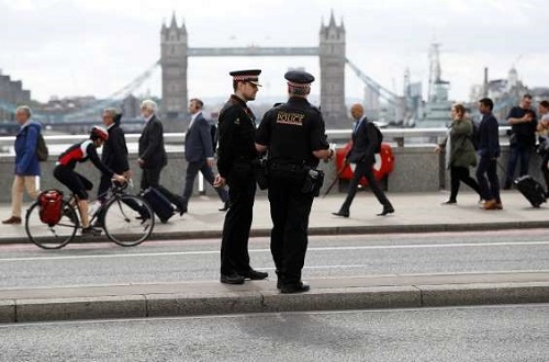 Special Constabulary policing on London Bridge with Tower Bridge in the background