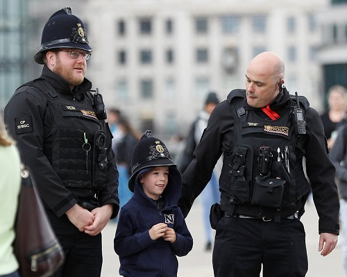 Special Constables with a happy child